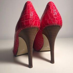 Pink snakeskin heels